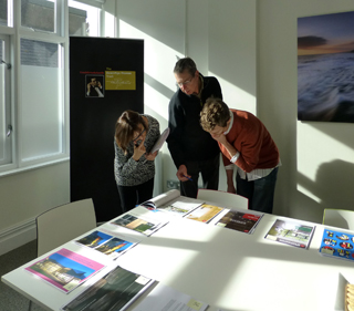The judges look over the submitted works